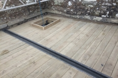Flat roof carpentry for lead flat roof on church in newton st petrock