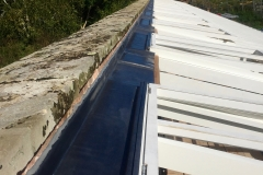 Lead back gutters to glass roof at Bicton College