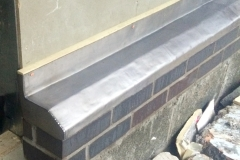 Lead cover to brick work at Braunton, school