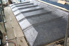 Sand cast lead flat roof