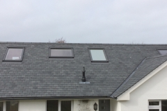 New slate roof with Velux windows and slate ridges in Ilfracombe