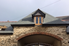 slate roof with mitred hips and lead to dormers in Lynton, North Devon