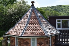Salvaged clay tile roof with new lead hips